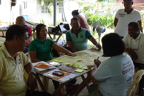 Oxfam partners and community representatives discuss how to implement their ideas. Guiuan, Eastern Samar Philippines April 2016. Photo: J.Fullwood-Thomas.